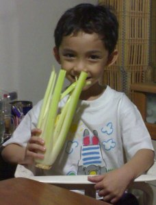 A photo of me eating celery