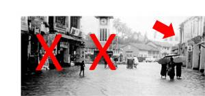 From old photo during flooding. X - already demolished. Arrow - going to demolish