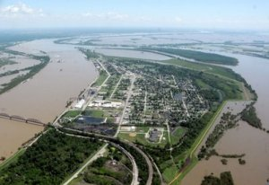 Paul Newton / The Southern The threat of massive flooding and a levee breach was lightened on Tuesday, May 3, after the Birds Point Levee (as seen in the distance) was breached by the Army Corps of Engineers.