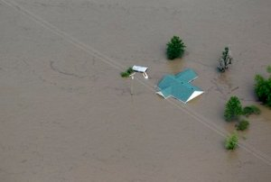 Tuesday, May 3, 2011, in Mississippi County, Mo.  Army Corps of Engineers' blew a two-mile hole into the Birds Point levee in southeast Missouri, which has flooded 130,000 acres of farmland in Missouri's Mississippi County in an effort to protect nearby Cairo, Ill. (AP Photo/Jeff Roberson)