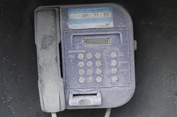 A city phone is seen covered with hoarfrost, with the air temperature at about minus 20 degrees Celsius (minus 4 degrees Fahrenheit), in Kiev, February 1, 2012. (REUTERS)