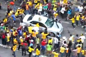 Demonstrators thew all kinds of things towards a moving police car and attacking the car. The photo shows demonstrators kicking the car and someone climbed onto the car kicking the windscreen. They then hit the driver and a reporter who tried to help the bleeding policeman. Are they peaceful people?