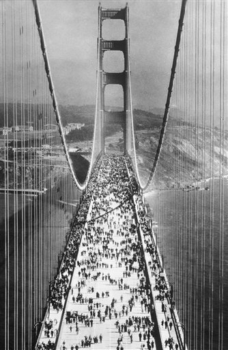 The Golden Gate Bridge at San Francisco, the longest suspension bridge in the world was opened on May 27, 1937. A view taken from one of the towers of pedestrians swarming across the Golden Gate Bridge immediately after the opening. (AP Photo)