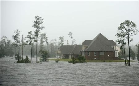 Water rises around a home on the Jourdan River as Hurricane Isaac passes through Kiln, Mississippi, August 29, 2012. REUTERS/Michael Spooneybarger