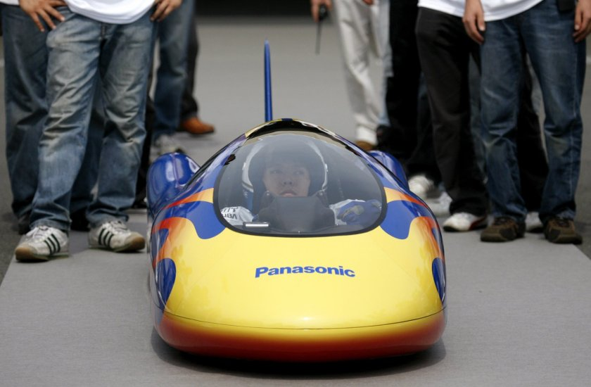 """Takashi Sudo, a student of Osaka Sangyo University, sits in a car powered by Panasonic's """"Oxyride"""" AA dry cell batteries before a Guinness World Record attempt at a vehicle test centre in Shirosato town, northeast of Tokyo August 4, 2007. According to the organizers, the collaboration of Panasonic and Osaka Sangyo University has achieved the new record for the fastest car powered by dry cell batteries with the average speed of 105.95 km/h (65.8 mph) for 1 km (0.6 miles), using 192 AA dry cell batteries. REUTERS/Kiyoshi Ota"""