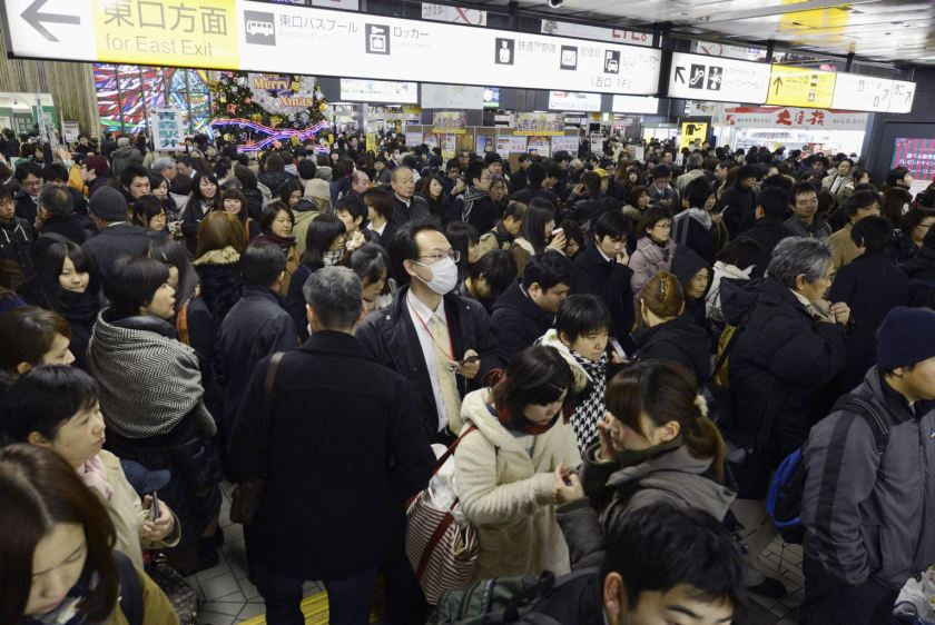People crowd at Sendai railway station in Sendai, Miyagi Prefecture, Friday, Dec. 7, 2012 after trains were halted following a strong earthquake struck off the coast of northeastern Japan. It is the same region that was hit by a massive earthquake and tsunami last year. (AP Photo/Kyodo News)