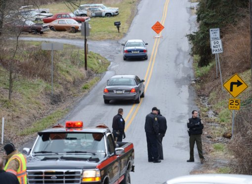 Local law enforcement block off road along Rt. 22 near the Canoe Creek State Park, Pa. while investigating a shooting, Dec. 21, 2012. (J.D. Cavrich/Altoona Mirror/AP)