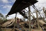 Residents rebuild their house which was destroyed by Typhoon Bopha in Compostela Valley, southern Philippines December 5, 2012. Blocked roads and severed communications in the southern Philippines frustrated rescuers on Wednesday as teams searched for hundreds of people missing after the strongest typhoon this year killed at least 283 people. REUTERS/Erik De Castro