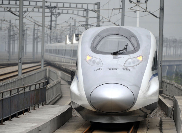 Associated Press/Xinhua, Chen Yehua - In this photo released by China's Xinhua news agency, a bullet train G80 leaves for Beijing from the Guangzhou South Railway Station in Guangzhou, capital of south China's Guangdong Province, Wednesday, Dec. 26, 2012. China has opened the world's longest high-speed rail line, which runs 2,298 kilometers (1,428 miles) from the country's capital in the north to Guangzhou, an economic hub in the Pearl River delta in southern China. (AP Photo/Xinhua, Chen Yehua)