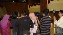My father (R) recorded the press interviewing one of the speakers, Uncle Naser Disa after the event.