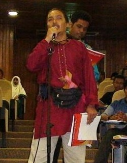 A participant with a keris asking a question during the 'Question and Answer' session.