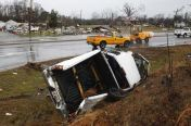 A destroyed vehicle lies flipped on one side along the road after a tornado hit in Adairsville, Georgia, January 30, 2012. Tornadoes were reported in four states killing two people including one in Adairsville as an Artic cold front clashed with warm air producing severe weather over a wide swath of the nation. REUTERS/Tami Chappell