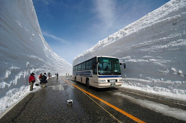 These snow walls along the Tateyama Kurobe Alpine Route are upwards of 65 feet high. Image by Pietro Zanarini.