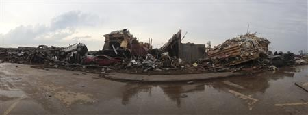 Destroyed buildings and overturned cars are seen after a huge tornado struck Moore, Oklahoma, near Oklahoma City, May 20, 2013. REUTERS/Richard Rowe