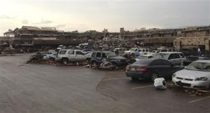 A shopping center and parking lot are filled with debris after a huge tornado struck in Moore, Oklahoma near Oklahoma City, Oklahoma May 20, 2013. REUTERS/Richard Rowe