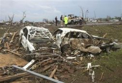 Destroyed cars are seen after a huge tornado struck Moore, Oklahoma May 20, 2013. REUTERS/Gene Blevins