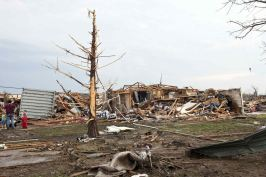 Stripped trees and destroyed houses remain after a huge tornado struck Moore, Oklahoma, near Oklahoma City, May 20, 2013. REUTERS/Richard Rowe