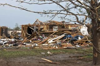 A destroyed house remains after a huge tornado struck Moore, Oklahoma, near Oklahoma City, May 20, 2013. A massive tornado tore through the Oklahoma City suburb of Moore on Monday, killing at least 51 people as winds of up to 200 miles per hour (320 kph) flattened entire tracts of homes, two schools and a hospital, leaving a wake of tangled wreckage. REUTERS/Richard Rowe (UNITED STATES – Tags: DISASTER ENVIRONMENT)