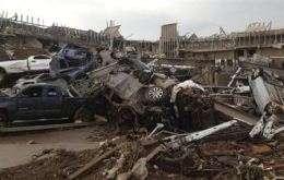 Overturned cars are seen after a huge tornado touched down in the town of Moore, near Oklahoma City, Oklahoma May 20, 2013. REUTERS/Richard Rowe