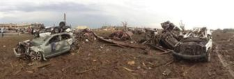 Overturned cars are seen after a massive tornado touched down near Oklahoma City, Oklahoma May 20, 2013. REUTERS/Richard Rowe
