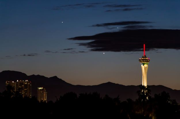 This conjunction of Jupiter, Venus and Mercury was shot in Las Vegas with the Stratosphere in the foreground. (Photo by lybrand/ Credit to Yahoo News).