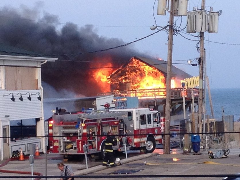 A massive fire raging for hours burned several blocks of boardwalk and businesses Thursday, Sept. 12, 2013 in a New Jersey shore town that was still rebuilding from damage caused by Superstorm Sandy. More than three hours after the fire started in the vicinity of an ice cream shop, television footage showed flames still leaping into the sky and thick black smoke covering a stretch of the coastline.