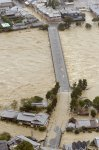 "An aerial view shows the flooded Katsura river and the partially-submerged Togetsu bridge as tropical storm Man-yi, locally named Typhoon No.18, makes landfall in Kyoto, western Japan, in this photo taken by Kyodo September 16, 2013. Torrential rain hit western Japan on Monday morning as Man-yi made landfall in the country's central region, prompting the weather agency to warn of ""unprecedented heavy rain"" and urge people to take safety precautions. In Kyoto Prefecture, some 260,000 residents were ordered to evacuate, including about 81,000 in Fukuchiyama, Kyodo news reported. Mandatory Credit. REUTERS/Kyodo"
