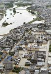 "An aerial view shows residential areas flooded by the Katsura river after tropical storm Man-yi, also known locally as Typhoon No.18, hit Kyoto, western Japan, in this photo taken by Kyodo September 16, 2013. Torrential rain hit western Japan on Monday morning as the Man-yi made landfall in the country's central region, prompting the weather agency to warn of ""unprecedented heavy rain"" and urge people to take safety precautions. In Kyoto Prefecture, some 260,000 residents were ordered to evacuate, including about 81,000 in Fukuchiyama, Kyodo news reported. Mandatory Credit. REUTERS/Kyodo"