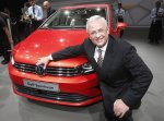 Volkswagen CEO Martin Winterkorn poses alongside the new Golf Sportsvan during a preview by the Volkswagen Group prior to the 65th Frankfurt Auto Show in Frankfurt, Germany, Monday, Sept. 9, 2013. (AP Photo/Frank Augstein)
