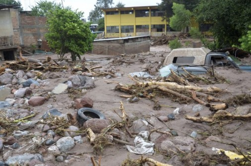 Mud and rubble cover vehicles and homes were swept away after a landslide caused by heavy rains came down on a low income neighbourhood in the city of Chilpancingo, Mexico, Monday Sept. 16, 2013. (Alejandrino Gonzales/ AP)
