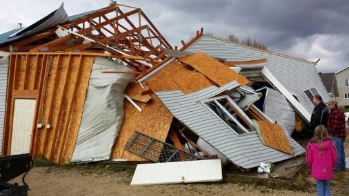 A garage in the Town of Hustisford collapsed and walls were turned inside-out after severe weather moved through the area Sunday, Nov. 17, 2013. Intense thunderstorms and tornadoes swept across the Midwest on Sunday, causing extensive damage in several central Illinois communities while sending people to their basements for shelter. (AP Photo/Dodge County Emergency Management, Joseph Meagher)