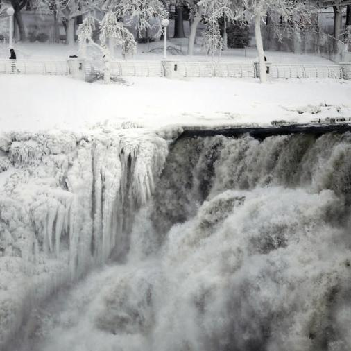 "The U.S. side of the Niagara Falls is pictured in Ontario, January 8, 2014. The frigid air and ""polar vortex"" that affected about 240 million people in the United States and southern Canada will depart during the second half of this week, and a far-reaching January thaw will begin, according to AccuWeather.com. (REUTERS/Aaron Harris)"