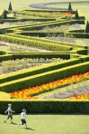 People enoy the sunny weather in the gardens at the Parterre in Cliveden House, Buckinghamshire (Rex Features)