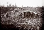 Horses and soldiers stand among the debris in a destroyed spot on the battlefield at Maurepas on the Somme front, northern France October 1916. (REUTERS/Collection Odette Carrez)