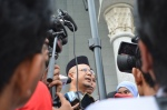 The medias rushed to interview Uncle Zul after the court decision was announced, June 23, 2014.