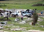 People sort through debris after Tuesday night's storm, on Wednesday, July 9, 2014, in Smithfield, N.Y. (AP Photo/Mike Groll)