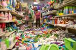 Elvira Balbazar, an employee at the 3J's Oreintal Market cleans up after an earthquake Sunday, Aug. 24, 2014, in American Canyon, Calif. (AP Photo/Rich Pedroncelli)