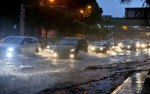 Vehicles have no choice but to move slowly due to the flash flood during an observation in Jalan Tun Razak - BERNAMA.