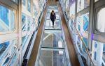 A visitor crosses the vertigo-inducing walkway. (Getty)