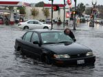 Mark Kunze of San Bruno, Calif., pushes his stalled vehicle out of the flooded intersection of Airport Boulevard and Grand Avenue in South San Francisco. (Photo: Alex Washburn, AP)