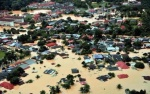 ANTARA kawasan yang dinaiki banjir di sekitar Manek Urai ketika tinjauan di sekitar Kelantan hari ini. – Foto BERNAMA