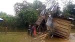 Sebuah rumah musnah dan dihanyutkan ke atas jalan raya di Kampung Aur Gading, Lipis, semalam. (Photo credit to Utusan Online)