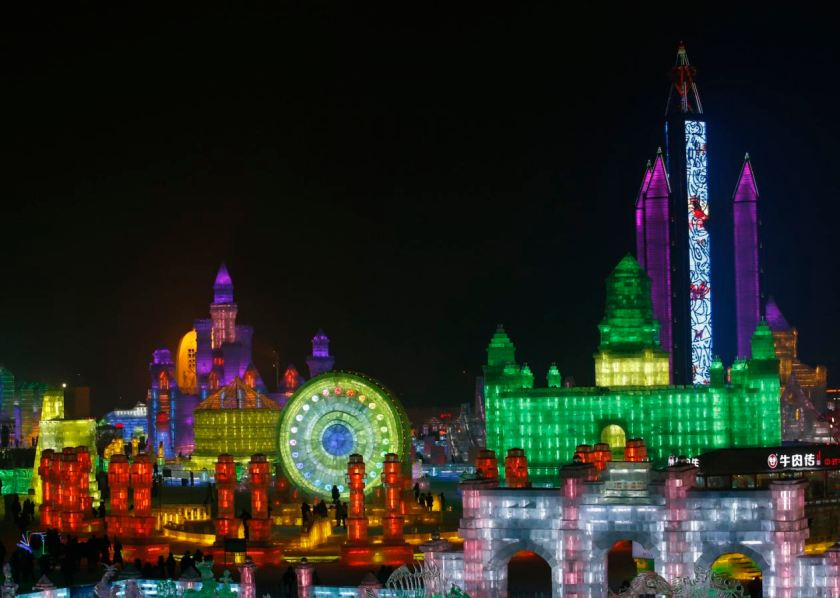 People visit ice sculptures illuminated by coloured lights during a trial operation ahead of the 31st Harbin International Ice and Snow Festival in the northern city of Harbin, Heilongjiang province, January 4, 2015. (REUTERS/Kim Kyung-Hoon)
