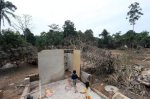 Children play near the area where their toilet used to be before their house was swept by flood in Kampung Sok Luar near Kuala Krai January 1, 2015. NSTP/Bazuki Muhammad  (for search string purposes : banjir)