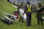 TAIPEI, TAIWAN - FEBRUARY 04:  A rescue crew carries a window from a TransAsia Airways ATR 72-600 turboprop airplane that crashed into the Keelung River shortly after takeoff from Taipei Songshan airport on February 4, 2015 in Taipei, Taiwan. Over 50 people were onboard the aircraft when it clipped a bridge and crashed into the river. Twelve deaths have currently been reported. (Photo by Ashley Pon/Getty Images)