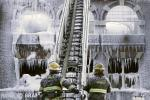 Philadelphia firefighters work the scene of an overnight blaze in west Philadelphia, Monday, Feb. 16, 2015, as icicles hang from where the water from their hoses froze. Bone-chilling, single-digit temperatures have gripped the region, prompting the closure of all parish and regional Catholic elementary schools in the city of Philadelphia. (AP Photo/Jacqueline Larma)