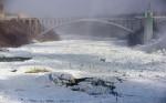 The Rainbow Bridge above a frozen river.