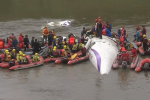 Rescuers work to find survivors from the downed plane.
