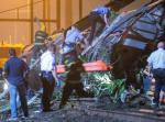 Emergency responders search for passengers following an Amtrak train derailment in the Frankfort section of  Philadelphia, Pennsylvania, May 12, 2015. An Amtrak passenger train with more than 200 passengers on board derailed in north Philadelphia on Tuesday night, killing at least five people and injuring more than 50 others, several of them critically, authorities said. Authorities said they had no idea what caused the train wreck, which left some demolished rail cars strewn upside down and on their sides in the city's Port Richmond neighborhood along the Delaware River. REUTERS/Bryan Woolston