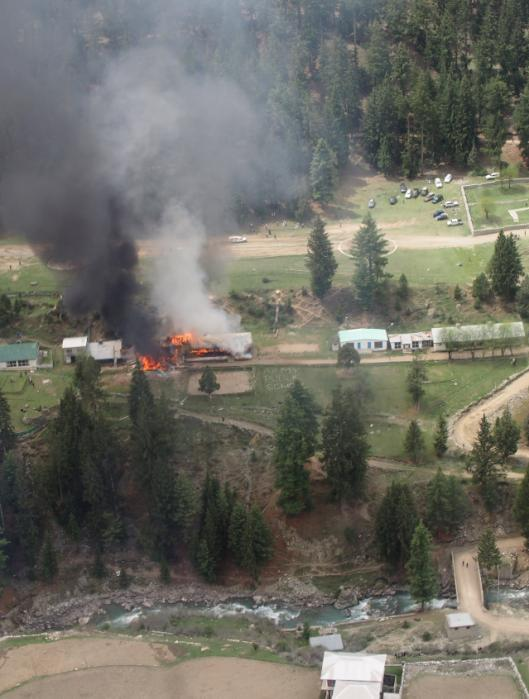 Smoke rises from a fire at the site of a helicopter crash that killed the ambassadors to Pakistan from the Philippines and Norway and the wives of the ambassadors from Malaysia and Indonesia in Gilgit, Pakistan, Friday, May 8, 2015. The diplomats and diplomatic sposes were among seven people killed Friday when a Pakistani army helicopter carrying foreign dignitaries crash landed in the country's north. (Maha Mussadaq/The Express Tribune via AP)